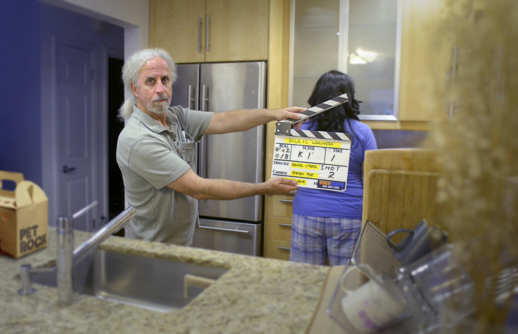 Dan Holden working the slate on the independent film set.